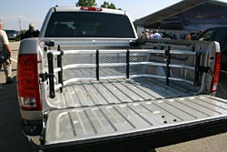 A clever bed rail cargo system consists of three bars, to which any number of dealer-available accessories are attached
