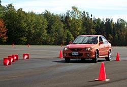 Greg Wilson and 2003 MazdaSpeed Protegé, Photo:  G. Yoxon