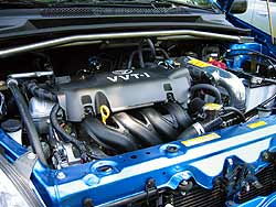 RS engine compartment showing strut tower brace and cold air intake