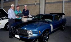 "Lebanon, Tenn. -- Mustang legend Carroll Shelby (L) and Ford Division President Steve Lyons (R) present ""Ford's Choice Award"" to David Reynolds, of Blacksburg, VA., and his 1970 BOSS Mustang."
