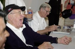 "DEARBORN, MI (June 14,2003)-  ""Racing Great"" Carroll Shelby shares a joke with a fan during autograph session at Ford's Centennial Celebration at Ford World Headquarters ."