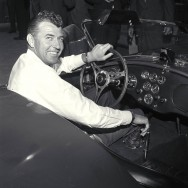 Cobra publicity, Venice, CA, 1963. Carroll Shelby at the wheel of a new Cobra production car. CD#0777-3292-0895-13.