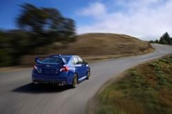 2015-Subaru-WRX-STI-rear-end-in-motion-02