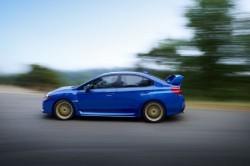 2015-Subaru-WRX-STI-side-in-motion-02
