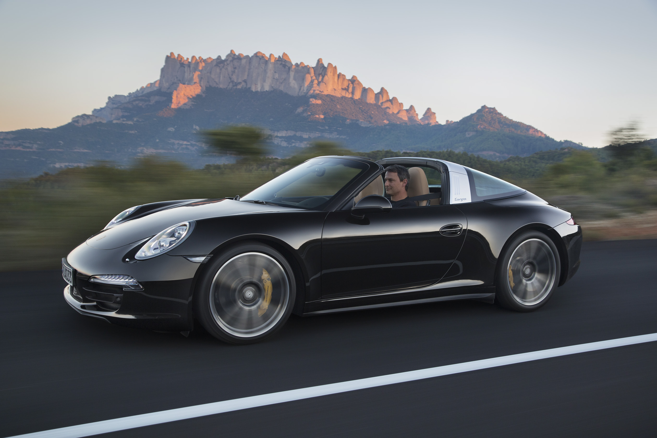 Naias porsche drops top raises roof hoop on new 991 targa 4 autos both cars also have a destination charge of 995 usd deliveries of the 911 targa in the us are scheduled to begin this summer sciox Image collections