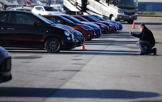 A person takes a photo of the Fiat Abarth at The 2013 Canadian Car of the Year Awards TestFest event in Niagara-on-the-Lake on Monday, October 22, 2012.